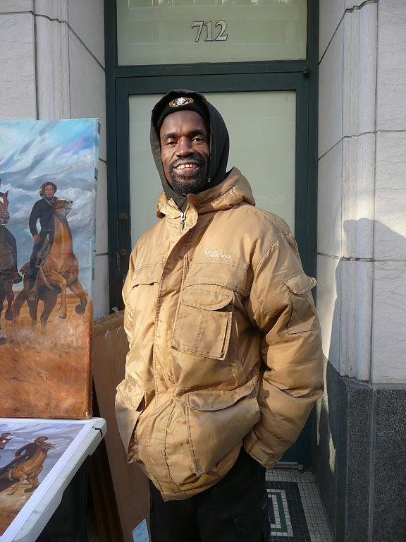 576px-Artist_Kolongi_Brathwaite_and_his_painting_Freedom_Riders_at_Inauguration_2013
