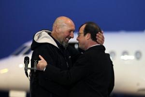 Serge Lazarevic  et le président français François Hollande