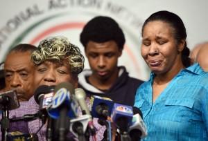 Al Sharpton, Gwen Carr, la mère d'Eric Garner, et sa veuve Esaw