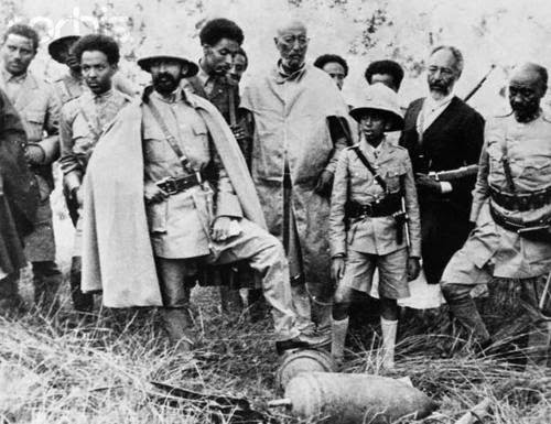 HIM with one foot on an undetonated bomb shortly after an Italian air bombardment during the Italo-Ethiopian War 1935-1936 near Addis Ababa